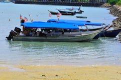 Island hopping boats to beautiful tropical island Stock Photo