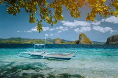 Island hopping trip El Nido. Incredible dreamlike exotic scenery with traditional filippino banca boat resting in. Turquoise water. tropical Palawan Island stock photo