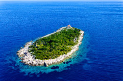Island Host. With smaller lighthouse. Island in placed few hundreds meters from north shore of island Vis Stock Photo