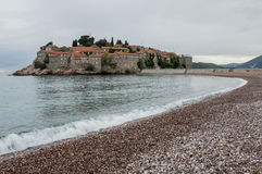Island-hotel Sveti Stefan. The beaches of Sveti Stefan are formed on both sides of the strip that connects the town-hotel of Sveti Stefan with the coast. Those Royalty Free Stock Photo