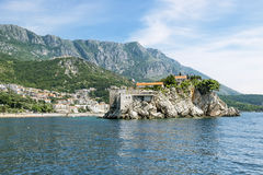 Island-hotel of Sveti Stefan in Montenegro on a  summer day Stock Photo