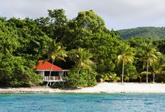 Island house on a beach. Red roof island house on tropical beach royalty free stock photography