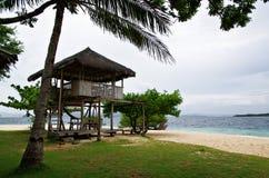 Island Hut. A breezy native beach-side hut Royalty Free Stock Photos