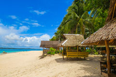 Island huts on Tropical Beach Royalty Free Stock Images