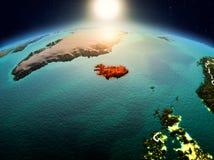 Island i soluppgång från omlopp Royaltyfri Fotografi