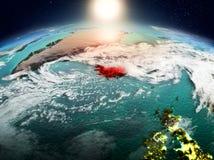 Island i soluppgång från omlopp Fotografering för Bildbyråer