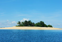 Island and islets. Gorgeous and green island and islets in the middle of the sea Stock Image
