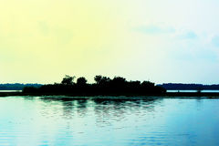 Island isolate in the lake yellow light shines Royalty Free Stock Photo