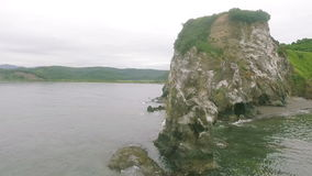 Island in Kamchatka. Rocks in the Pacific Ocean stock footage