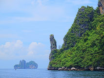 Island in Krabi. Green mountains and rock with large white cloud sky at PhiPhi island in Krabi, Thailand Royalty Free Stock Photos