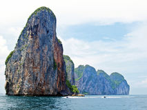 Island in Krabi. Green mountains and rock with large white cloud sky at PhiPhi island in Krabi, Thailand Stock Image