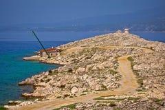 Island of Krk stone desert strand and Silo lighthouse view. Kvarner bay of Croatia stock photos