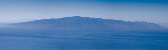 Island of La Gomera from Tenerife. Shows the island of La Gomera taken from a tree lined hillside vantage point in Tenerife. Also just visible is the island of royalty free stock photo