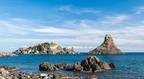 Island Lachea and a sea stack, geological features in Acitrezza (Sicily) Stock Photography