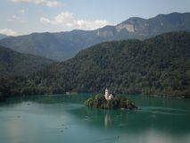 Island on a Lake. An island on a lake surrounded by mountains in Slovenia royalty free stock photography