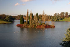 Island in the Lake. Autumnal scene over small lake stock photography