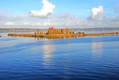 Island on lake in the autumn Stock Photography