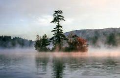 Island on lake in autumn Stock Photos