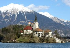 Island of Lake BLED in SLOVENIA and the snowy mountains. Church on the island of Lake BLED in SLOVENIA Europe and the snowy mountains in the background Royalty Free Stock Photo
