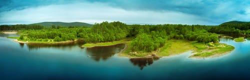 Island on lake Stock Images