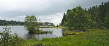 Island on the lake servieres in the puy de dome. Panoramic view of the lake servieres in the puy de dome Stock Images
