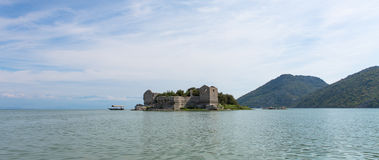 Island in Lake Skadar. The old ruined prison is situated on the Skadar lake - the biggest lake on the Balkan Peninsula. Famous around the world for its unique Stock Image