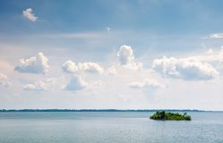 Island on the lake zemplinska sirava. Beautiful landscape of Slovakia. calm summer day with beautiful cloudscape on the sky. lovely minimalist background Royalty Free Stock Photography