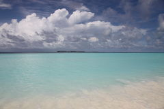 Island landscape in Maldives. A beach on an island of Maldives with cloudy sky, storm coming Stock Photo
