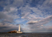 Island Lighthouse. St Mary's Island, near Whitley Bay, England, is a pretty white lighthouse than can be reached via a causeway at low tide royalty free stock photo