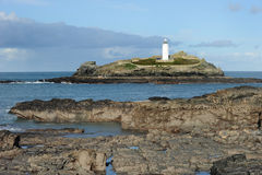 Island lighthouse. Godrevy lighthouse, St Ives Bay, Cornwall. Built in 1859 the light is now unmanned and solar powered Stock Photos