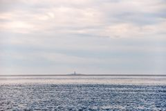 Island with a lighthouse on the horizon. White Sea. Arkhangelsk Region, Russia stock image