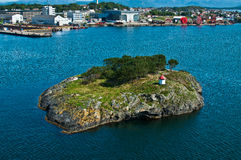 Island with lighthouse Stock Photos
