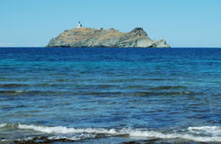 Island with lighthouse near Corsica royalty free stock photo