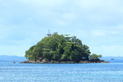 Island with the lighthouse Stock Images