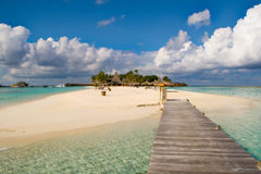 An island from maldives. Tropical island. Suitable for an idea of vacations, Caribbean or tropical  summer time Stock Photo