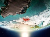 Island med solen på planetjord Arkivfoton