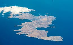 Island in the Mediterranean Sea. View from the plane on the island of the Mediterranean Sea Royalty Free Stock Photo