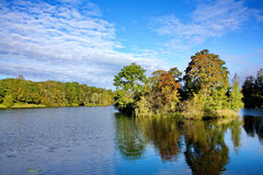 Island in the middle of the lake. Island with autumn trees in the lake Royalty Free Stock Image