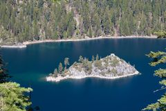 Island in middle of mountain lake Royalty Free Stock Photo