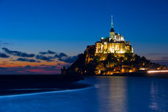 The Island of Mont St. Michel in Normandy, France. Mont Saint-Michel is a rocky tidal island and a commune in Normandy, located approximately one kilometer off Royalty Free Stock Photo