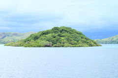 Island with the mountain Stock Images