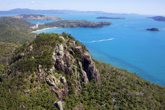 Hamilton Island and blue ocean. Hamilton Island, Queensland Australia. Tropical island surrounded by blue ocean. Mountainous landscape Royalty Free Stock Image
