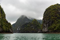 Island mountain tops of ha long bay in Vietnam in clouds stock image
