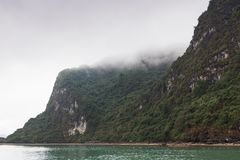 Island mountain tops of ha long bay in Vietnam in clouds royalty free stock photography