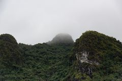 Island mountain tops of ha long bay in Vietnam in clouds stock photos