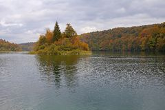 Island on mountin lake in autumn stock photography