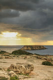 Island near the coast of Cyprus with a stormy sky Stock Photos