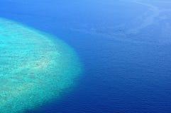 Island in the ocean Royalty Free Stock Photos