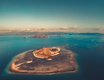 The island among the ocean. Aerial shot. Komodo. royalty free stock photography