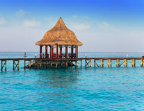 Island in ocean, arbor over water for rest Stock Image